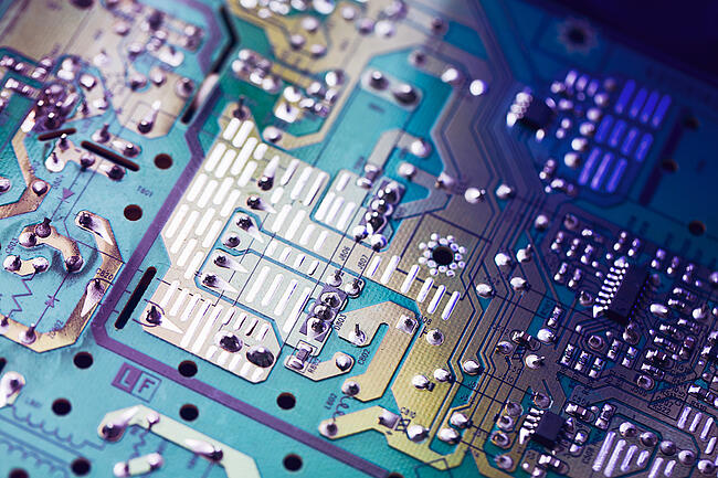 Close up of a printed circuit board showing the details of assembly.