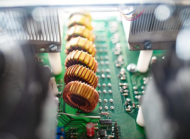 Close up of a small printed circuit board in manufacturing.