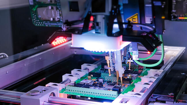 PCB board being assembled with robotics.