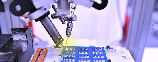 Electronic contract manufacturer robotic assembly.
