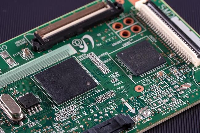 Close up of green printed circuit board.