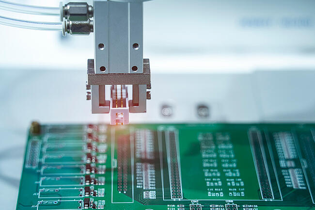 Robotic assembly of printed circuit board.